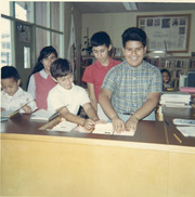 Martinez siblings at the City Terrace Library circulation desk, East Los Angeles, California