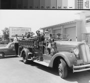 Fire Fighters and Children on Fire Truck, 1959