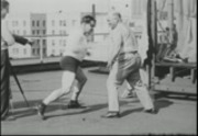 "Jess Willard and Frank Richards, the ""cast-iron"" human, on the roof of the Los Angeles Athletic Club"