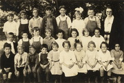 Group portrait of Miss Johnson and her class, Homestead School