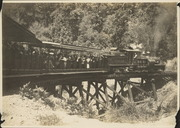 Mt. Tamalpais and Muir Woods Railway train and passengers cars crossing a trestle bridge