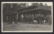 Group of men and three dogs in front of the Muir Woods Inn, early 1900s