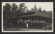 Group in front of Muir Woods Inn, with dog on hind legs
