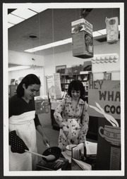 Two women cooking at library