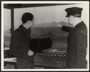 Two employees in the control tower