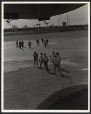 A group examines the underbelly of the Goodyear blimp
