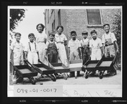 Boys with wheelbarrows at Chinese Baptist Mission