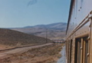 [Shots from passenger train through desert and San Francisco Bay Area]