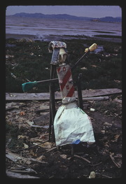 APR74P6-28: figure sculpture with manure bag skirt, By RS