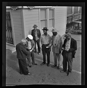 Group of men standing on the waterfront, California Labor School